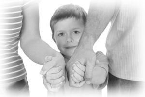 child_holding_parents_hands